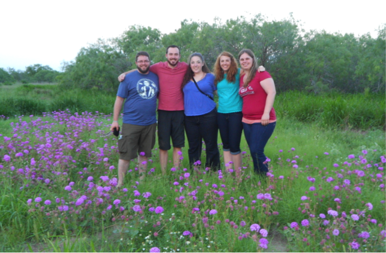 The team from UIndy standing in a field of Heart's Delight at the Lasater Ranch