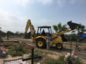 Silvestre and the backhoe.