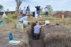 Leann and Dr. Latham uncovering a burial