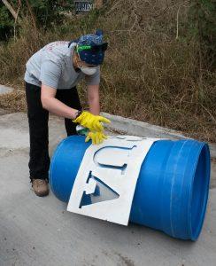 Erica painting new barrels