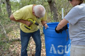 Eddie Canales building water stations in Brooks Co