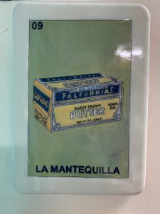 Lotería painting showing Falfurrias Butter at La Mota