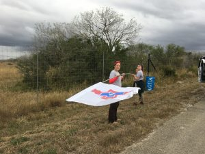 Angela, Arianna, and I raising a new flag at a water station