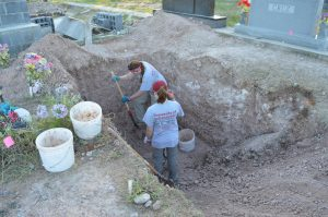 Dr. Latham and Haley digging the trench