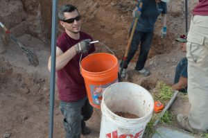 Dr. Goche moving dirt with a smile on his face