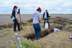 UIndy's team digging trenches to investigate the area