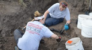 Dr. Latham and Jessica excavating a burial